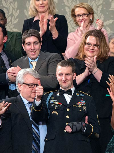U.S. Army Ranger Sgt. First Class Cory Remsburg, injured while serving in Afghanistan, during President Barack Obama's State of the Union speech on Capitol Hill in Washington, Jan. 28, 2014