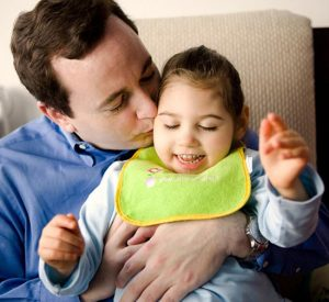 Patrick Donohue with his 5-year-old daughter Sarah Jane who was violently shaken as an infant and suffered permanent brain injury. Donohue now runs the Sarah Jane Brain Project, a non-profit dedicated to raising awareness of brain injury as well as helping families access resources to cope with having a child with TBI, Traumatic Brain Injury. Photographed at their home in NYC.