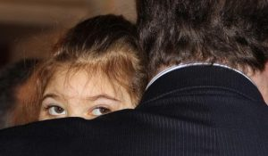 Sarah Jane Donohue peers over her father's shoulder